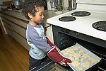 Young boy baking cookies