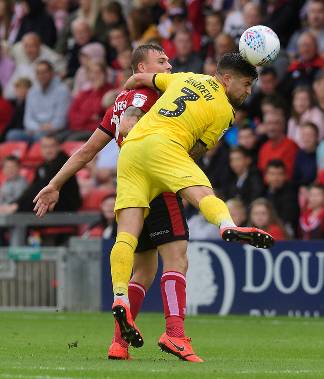 Fleetwood Town's Danny Andrew vies for possession with Lincoln City's Harry Anderson<br /> <br /> Photographer Chris Vaughan/CameraSport<br /> <br /> The EFL Sky Bet League One - Lincoln City v Fleetwood Town - Saturday 31st August 2019 - Sincil Bank - Lincoln<br /> <br /> World Copyright © 2019 CameraSport. All rights reserved. 43 Linden Ave. Countesthorpe. Leicester. England. LE8 5PG - Tel: +44 (0) 116 277 4147 - admin@camerasport.com - www.camerasport.com
