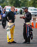 Aug 17, 2018; Brainerd, MN, USA; NHRA top fuel driver Richie Crampton (left) talks with Antron Brown during qualifying for the Lucas Oil Nationals at Brainerd International Raceway. Mandatory Credit: Mark J. Rebilas-USA TODAY Sports
