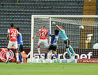 BOGOTA - COLOMBIA -14 -03-2015: Nikolas Vikonis (Der.) portero de Millonarios disputa el balón con Francisco Meza (Izq.) jugador de Independiente Santa Fe, durante partido entre Millonarios e Independiente Santa Fe por la fecha 10 de la Liga Aguila I-2015, jugado en el estadio Nemesio Camacho El Campin de la ciudad de Bogota. / Nikolas Vikonis (R) goalkeeper of Millonarios vies for the ball with Francisco Meza (L) player of Independiente Santa Fe, during a match between Millonarios and Independiente Santa Fe, for the  date 10 of the Liga Aguila I-2015 at the Nemesio Camacho El Campin Stadium in Bogota city, Photo: VizzorImage / Luis Ramirez / Staff.