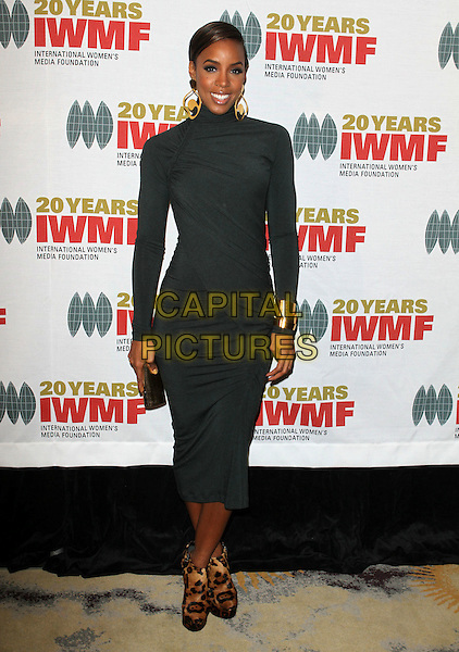 KELLY ROWLAND.The International Women's Media Foundation's Courage In Journalism Awards held at The Beverly Hills Hotel, Beverly Hills, CA, USA, .21st October 2010..full length grey gray dress mid long sleeve ruched polo neck ankle wedges boots animal leopard print platform  .CAP/ADM/KB.©Kevan Brooks/AdMedia/Capital Pictures.