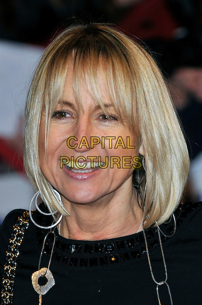 CAROL McGIFFIN.The 15th National Television Awards held at the O2 Arena, London, England..January 20th, 2010.NTA NTAs headshot portrait black silver earrings necklace smiling .CAP/PL.©Phil Loftus/Capital Pictures.