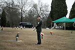 December 21, 2007. Charlotte, NC.. A funeral was held for Cpl. Joshua C. Blaney in Charlotte, NC. Cpl. Blaney died on December 12 from injuries sustained when an IED exploded near his vehicle in Afghanistan. He was 25.. The bugler who will play taps at the gravesite waits for his cue to perform.