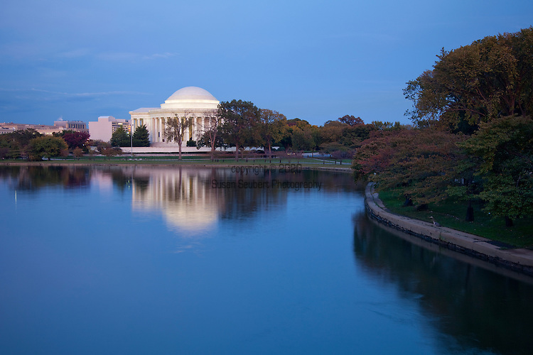 The Jefferson Memorial and the Washington Monument glow in the evening light as seen from the Tidal Basin