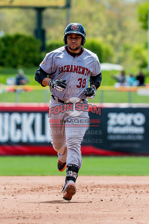Miguel Olivo (38) of the Sacramento River Cats  rounds the bases after hitting a home run against the Salt Lake Bees in Pacific Coast League play at Smith's Ballpark on May 01,  2016 in Salt Lake City, Utah. Sacramento defeated Salt Lake 16-6.  (Stephen Smith/Four Seam Images)