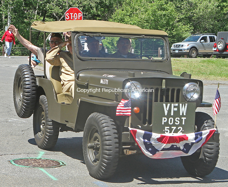 Thomaston, CT-052713MK13 Members of the V.F.W Post 572 salute and wave tot he crowds during the Memorial Day parade in Thomaston on Monday morning.  Michael Kabelka / Republican-American.