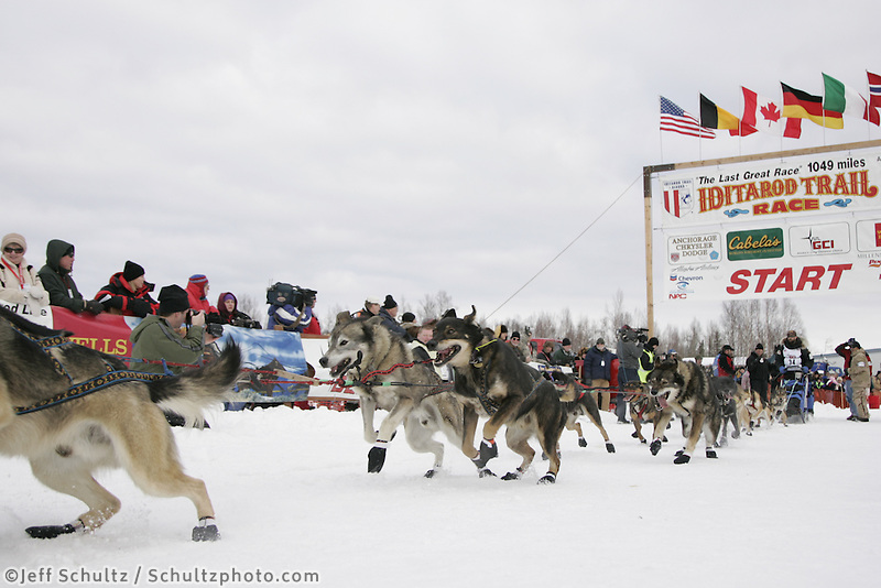 Rick Casillos dogs lunge at the restart of the 2008 Iditarod in Willow