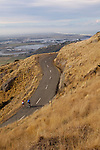 Cyclists on twisty road on the Banks Peninsula, Christchurch, New Zealand