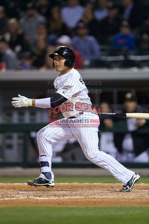 Carlos Sanchez (2) of the Charlotte Knights follows through on his swing against the Durham Bulls at BB&T BallPark on April 14, 2016 in Charlotte, North Carolina.  The Bulls defeated the Knights 2-0.  (Brian Westerholt/Four Seam Images)