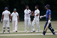 Taqi Abbas of Harold Wood celebrates taking the wicket of Ollie Ekers during Harold Wood CC vs Shenfield CC (batting), Essex Cricket League Cricket at Harold Wood Park on 25th July 2020