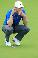 Oliver Fisher (ENG) on the 2nd green during Thursday's Round 1 of the 2014 BMW Masters held at Lake Malaren, Shanghai, China 30th October 2014.<br /> Picture: Eoin Clarke www.golffile.ie