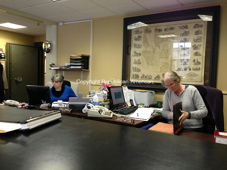 WOODBURY, CT - 20 Dec 2013 - 122013RH01 - Town Clerk Linda Carlson, left, and Assistant Town Clerk Suzanne Cooper, right, work in the Boyd Building in Woodbury. Data entry errors with land use records going back for years have occupied much of the office's time. Rick Harrison Republican-American