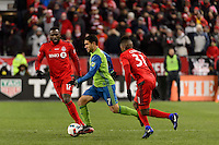 Toronto, ON, Canada - Saturday Dec. 10, 2016: Jozy Altidore, Cristian Roldan, Armando Cooper during the MLS Cup finals at BMO Field. The Seattle Sounders FC defeated Toronto FC on penalty kicks after playing a scoreless game.