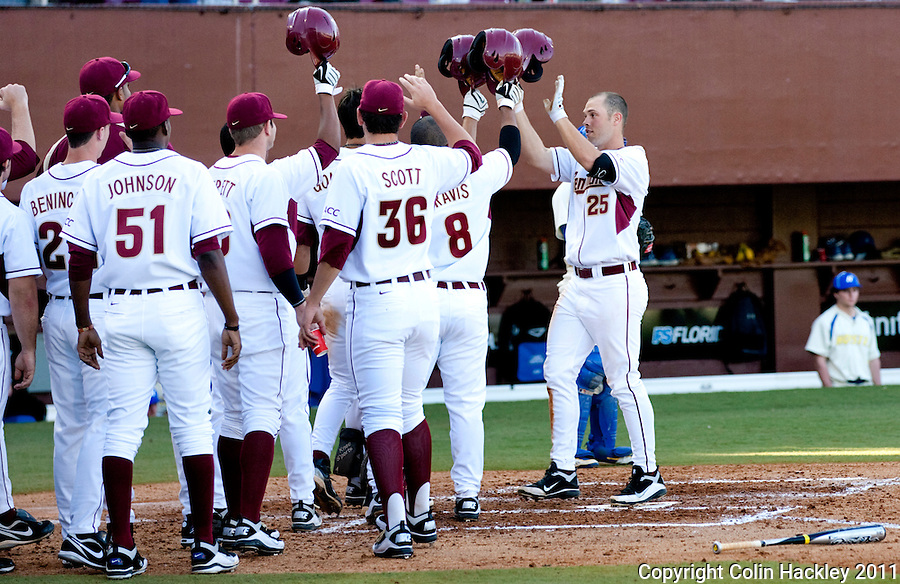 TALLAHASSEE, FL 2/26/11-FSU-HOFSTRA BASE11 CH-Florida State's Mike McGee, right, celebrates his grand slam home run during fourth inning action against Hofstra Saturday at Dick Howser Stadium in Tallahassee. The Seminoles beat the Pride 16-3...COLIN HACKLEY PHOTO