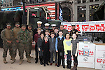 Dan Lauria, Johnny Rabe & the cast of 'A Christmas Story, The Musical' visit the Marine Corps Reserve 'Toys For Tots', Times Square, New York City on December 20, 2012