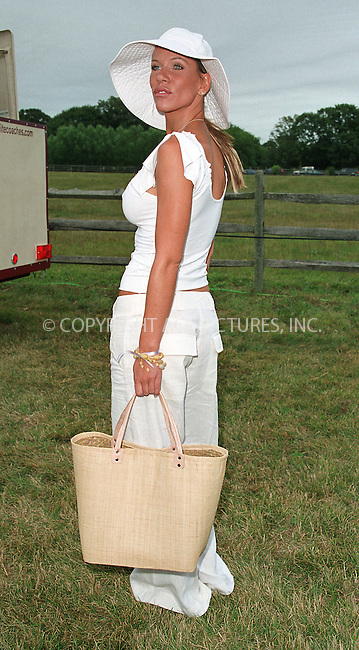"Singer Mia Girard at the Fifth Annual ""Super Saturday"" designer sale and family event to benefit the ovarian cancer research fund. Water Mill, Long Island. July 27, 2002. Please byline: Alecsey Boldeskul/NY Photo Press.   ..*PAY-PER-USE*      ....NY Photo Press:  ..phone (646) 267-6913;   ..e-mail: info@nyphotopress.com"