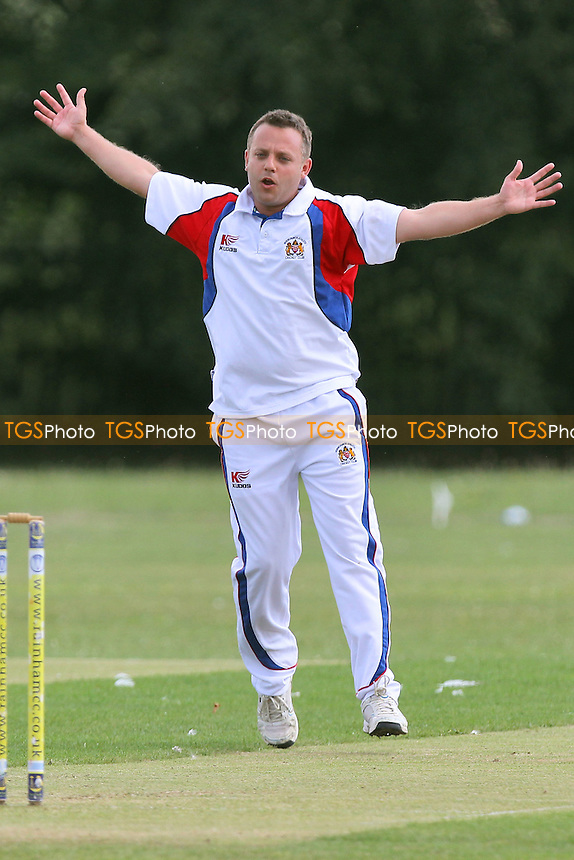Hornchurch Athletic claim the third Rainham wicket - Rainham CC 3rd XI (batting) vs Hornchurch Athletic CC 4th XI - Mid-Essex Cricket League at Spring Park Farm - 26/07/14 - MANDATORY CREDIT: Gavin Ellis/TGSPHOTO - Self billing applies where appropriate - contact@tgsphoto.co.uk - NO UNPAID USE