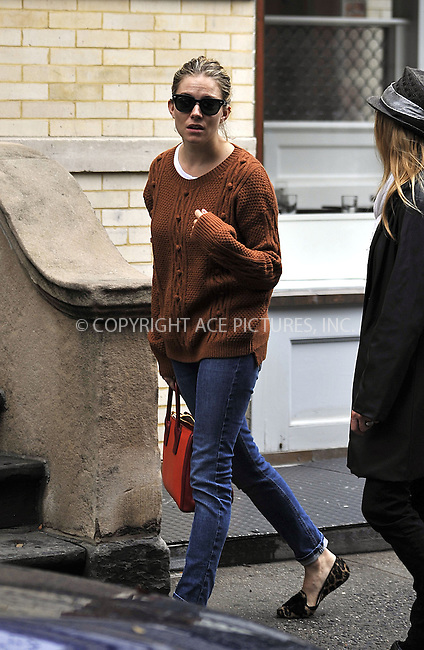 WWW.ACEPIXS.COM....October 10 2012, New York City....Actress Sienna Miller walks in the West Village on October 10 2012 in New York City....By Line: Curtis Means/ACE Pictures......ACE Pictures, Inc...tel: 646 769 0430..Email: info@acepixs.com..www.acepixs.com