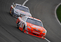 Feb 22, 2009; Fontana, CA, USA; NASCAR Sprint Cup Series driver Joey Logano leads Scott Speed during the Auto Club 500 at Auto Club Speedway. Mandatory Credit: Mark J. Rebilas-
