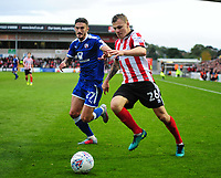 Lincoln City's Harry Anderson vies for possession with Chesterfield's Bradley Barry<br /> <br /> Photographer Andrew Vaughan/CameraSport<br /> <br /> The EFL Sky Bet League Two - Lincoln City v Chesterfield - Saturday 7th October 2017 - Sincil Bank - Lincoln<br /> <br /> World Copyright &copy; 2017 CameraSport. All rights reserved. 43 Linden Ave. Countesthorpe. Leicester. England. LE8 5PG - Tel: +44 (0) 116 277 4147 - admin@camerasport.com - www.camerasport.com