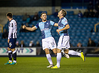Garry Thompson of Wycombe Wanderers (right) scores and celebrates during the Checkatrade Trophy round two Southern Section match between Millwall and Wycombe Wanderers at The Den, London, England on the 7th December 2016. Photo by Liam McAvoy.