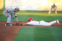 Peoria Chiefs third baseman Paul DeJong (7) slides into the bag as second baseman Tucker Neuhaus (10) swipes the tag during a game against the Wisconsin Timber Rattlers on August 21, 2015 at Dozer Park in Peoria, Illinois.  Wisconsin defeated Peoria 2-1.  (Mike Janes/Four Seam Images)