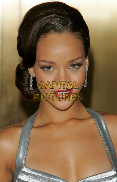 RIHANNA .Arrivals at the Conde Nast Media Group's Third Annual Fashion Rocks Concert, held at Radio City Music Hall, .New York City, NY, USA,7 September 2006..portrait headshot red lipstick earrings full length grey silver dress.Ref: ADM/JL.www.capitalpictures.com.sales@capitalpictures.com.©Jackson Lee/AdMedia/Capital Pictures.