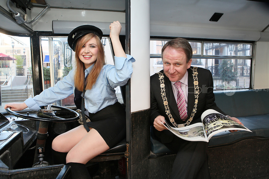 "NO FEE. 20/10/2010. Vintage CIE Double Decker Bus Makes One Last Stop . Beautiful 'conductor' Jane Kendlin and The Lord Mayor, Cllr Gerry Breen are pictured in full conductor's uniform to mark the launch of two new books on CIE Buses in the 1970's and 1980's, a vintage CIE double decker bus, outside the Mansion House on Dawson Street, Dublin.he coffee table books have been published by PRC Publications, a new transport publications company based in Dublin, and feature a miscellany of photographs of Irish buses and street scenes in both rural and urban locations, taken by Ed O'Neill from mid 1970 to mid 1980. A self-confessed ""bus nut"", O'Neill has compiled the two books which will appeal to both enthusiasts and the general public alike. Urban street scenes, including traffic on Dublin's Grafton Street, will remind readers of a time long gone when traffic regulations were far more relaxed and beautiful buildings stood tall, many of which are sadly no longer in existence. The books, 'CIE Buses in the 1970s and 80s - Double Deckers' and 'CIE Buses in the 1970s and 80s - Single Deckers' are priced at EUR25.00 per book (or both books for EUR45.00) and are available from Mark's Models branches or online at www.prcpublications.com. Picture James Horan/Collins Photos"