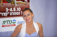 "Caroline Weber of Austria smiles to camera at ""kiss & cry"" during event finals at 2010 Holon Grand Prix at Holon, Israel on September 4, 2010.  (Photo by Tom Theobald)."