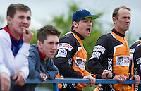 19 APR 2015 - IPSWICH, GBR - Three times British Champion Andy Angell (centre in blue hat) cheers on a team mate as he watches a heat during the Elite League cycle speedway fixture against Ipswich Eagles at Whitton Sports and Community Centre in Ipswich, Suffolk, Great Britain (PHOTO COPYRIGHT © 2015 NIGEL FARROW, ALL RIGHTS RESERVED)