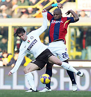 Inter's Maxwell and Bologna's Gaby Mudingayi during their italian serie A soccer match at Dall'Ara Stadium in Bologna , Italy , February 21 , 2009 - Photo: Prater/Insidefoto ©