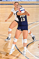 24 September 2010:  FIU's Chanel Araujo (13) returns a serve in the second set as the FIU Golden Panthers defeated the University of Denver Pioneers, 3-0 (29-27, 25-16, 25-20), at U.S Century Bank Arena in Miami, Florida.