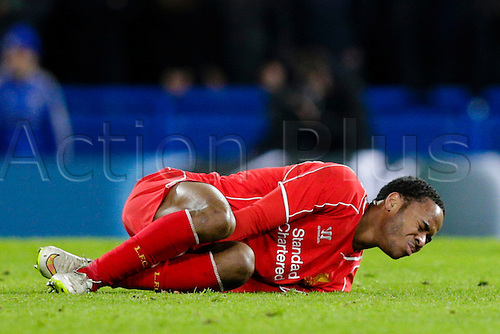 27.01.2015.  London, England. Capital One Cup Semi-Final 2nd leg. Chelsea versus Liverpool.  Liverpool's Raheem Sterling lies in pain after a heavy challenge by Chelsea's John Terry (not pictured)