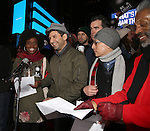 Denee Benton, Tony Yazbeck, Brian d'Arcy James, Francis Jue and Andre d'Shields attend The Ghostlight Project to light a light and make a pledge to stand for and protect the values of inclusion, participation, and compassion for everyone - regardless of race, class, religion, country of origin, immigration status, (dis)ability, gender identity, or sexual orientation at The TKTS Stairs on January 19, 2017 in New York City.
