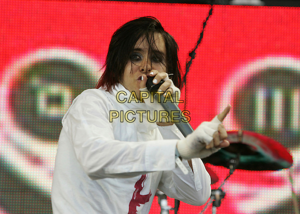 30 SECONDS TO MARS - JARED LETO.Perfoming live at The 2006 KROQ 106.7 Inland Invasion held at The Hyundai Pavilion in San Bernadino, California, USA, September 23rd 2006..half length concert gig festival music band on stage funny white costume make-up hand.Ref: DVS.www.capitalpictures.com.sales@capitalpictures.com.©Debbie VanStory/Capital Pictures