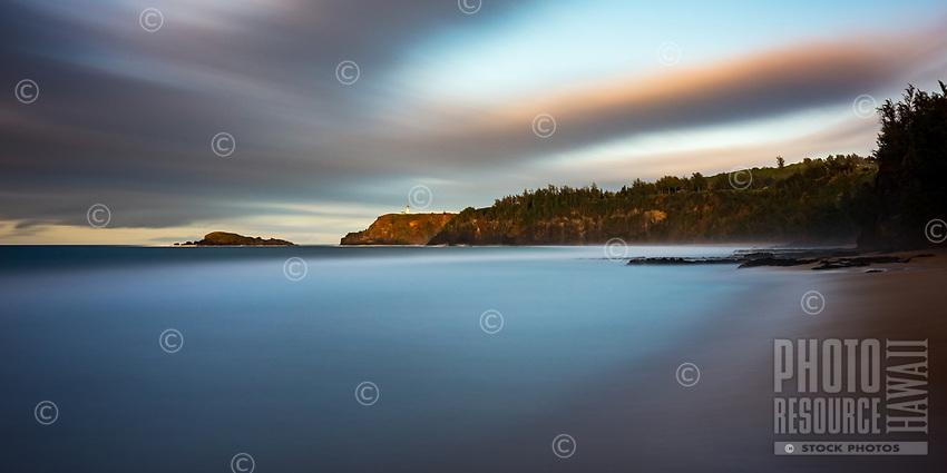 A 10-minute exposure at Secret (or Secret's) Beach as the last rays of the sun illuminate Kilauea Lighthouse, Kaua'i.