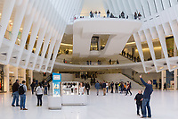 Shoppers and tourists enjoy the view inside the Oculus and stores in the Westfield World Trade Center mall in New York City.