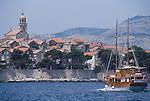 Croatia, Korcula Island, Korcula, Croatian spelling: Korčula, coastal port, Dalmatian Coast, historic Venetian architecture, tourist boat approaching, Adriatic Sea, Europe,.