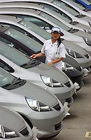 Worker at the Honda motor (China) Export plant in Guangzhou, China. The new Honda plant will produce and export the Honda Jazz model..
