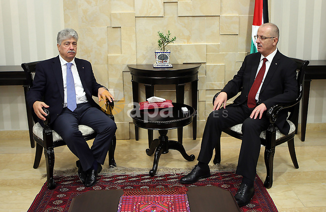Palestinian Prime Minister, Rami Hamdallah, receives the Annual report of the  Retirement Authority for 2015 in the West Bank city of Ramallah on July 11 , 2016. Photo by Prime Minister Office