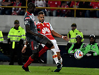 BOGOTA - COLOMBIA - 26 - 01 - 2018: Brayan Fernandez (Der.) player de Independiente Santa Fe disputa el balón con Danilo Arboleda (Izq.) jugador de America de Cali, durante partido entre Independiente Santa Fe y America de Cali, por el Torneo Fox Sports 2018, jugado en el estadio Nemesio Camacho El Campin de la ciudad de Bogota. / Brayan Fernandez (R) player of Independiente Santa Fe vies for the ball with Danilo Arboleda (L) player of America de Cali, during a match between Independiente Santa Fe y America de Cali, for the Fox Sports Tournament 2018, played at the Nemesio Camacho El Campin stadium in the city of Bogota. Photo: VizzorImage / Luis Ramirez / Staff.