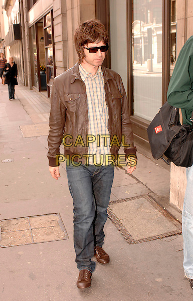NOEL GALLAGHER.Leaving the Portland Hospital today after becoming a father for the second time on Saturday. His partner Sarah MacDonald gave birth to a baby boy named Donovan Rory MacDonald Gallagher, London, England..September 24th, 2007.oasis full length jeans denim brown leather jacket sunglasses shades .CAP/FIN.©Steve Finn/Capital Pictures.