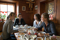 Neustift im Stubaital, Stubaier Hohenweg, Tirol, Austria, September 2008. four women have breakfast at the Neue Regensburger hutte.  Hiking the Stubai High Trail from hut to hut in the southern Alps, we clear a mountain pass on a daily basis. Photo by Frits Meyst/Adventure4ever.com.