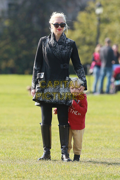 Gwen Stefani & Zuma Rossdale .Gwen Stefani and Zuma Rossdale in Primrose Hill Park, London, England..October 23rd, 2011.full length yellow joggers tracksuit red top sweatshirt blast gather together boots black leggings grey gray coat sunglasses shades mother mom mum son family kid child .CAP/HIL.©John Hillcoat/Capital Pictures .