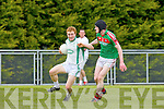 Thomas Hickey St Kieran's goes past Kilcummin Donal Maher during their County Championship clash in Brosna on Sunday