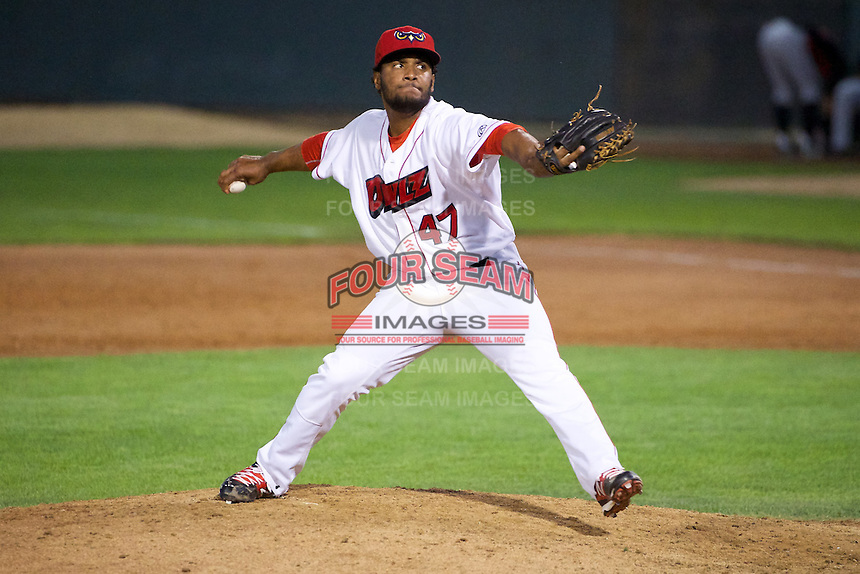 Ramon Rodriguez (47) of the Orem Owlz delivers a pitch to the plate against the Billings Mustangs in Pioneer League action at Home of the OWLZ on August 15, 2014 in Orem , Utah.  (Stephen Smith/Four Seam Images)