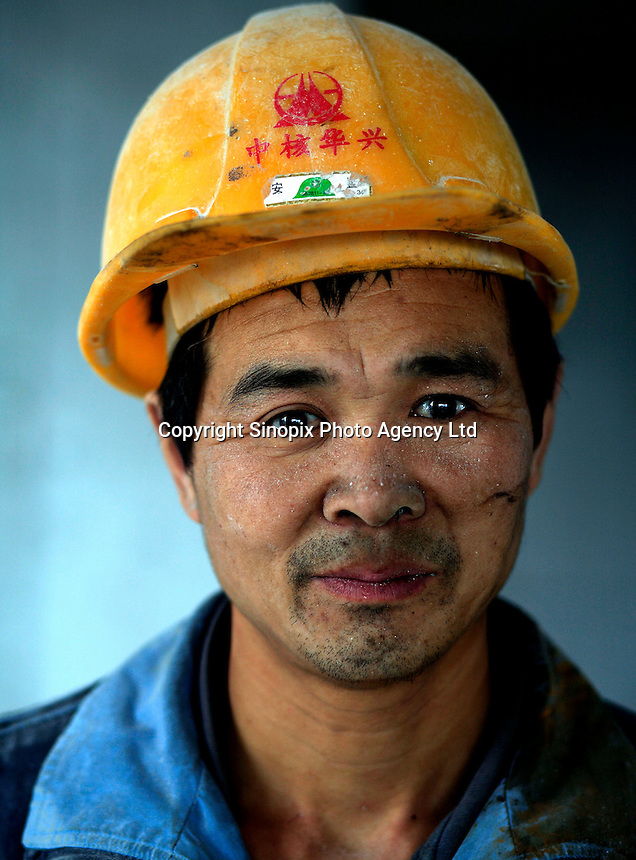 Portrait of a migrant worker in a construction site in Chongqing, China..