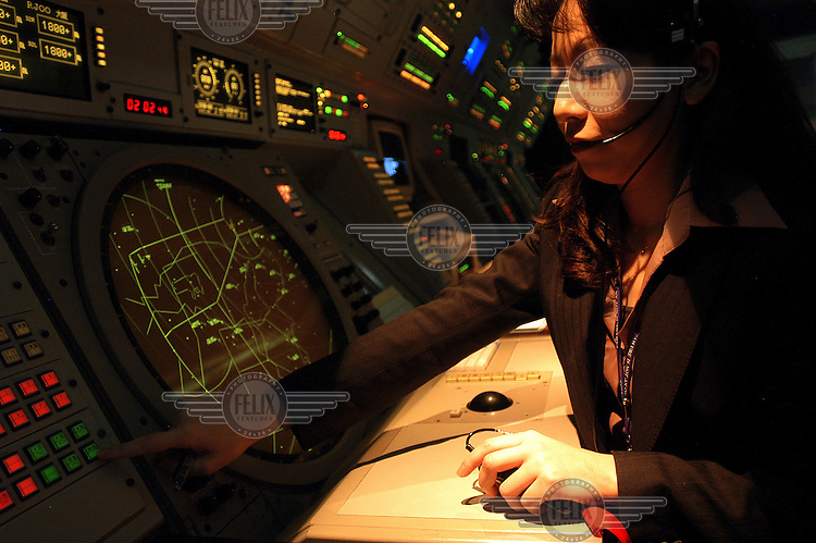 Female Air Traffic Controller at work in Kansai Airport.