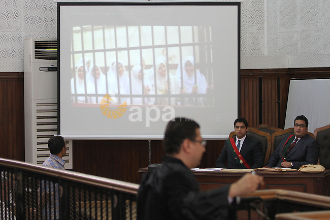 A member of defense authority of defendants in the Marriott terror cell case attends the trial in Cairo on May 22, 2014. A total of 20 defendants in the case are charged with harming Egypt's national interests by spreading false news and assisting or belonging to a terrorist organization, but 12 are being tried in absentia. Photo by Mohammed Bendari