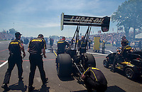 Jun. 1, 2014; Englishtown, NJ, USA; Crew members with NHRA top fuel driver Richie Crampton during the Summernationals at Raceway Park. Mandatory Credit: Mark J. Rebilas-